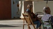 Poncho girl seated