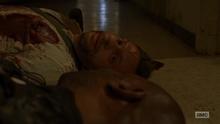 TD Morgan look at Freddie's corpse