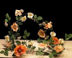 Artificial-flower-garland-yellow-orange-poppies