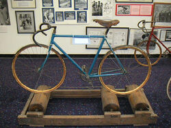 Antique bicycle on antique rollers in US Bicycling Hall of Fame