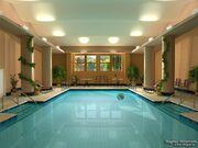 Indoor-swimming-pool-with-big-pillarsivy-plantationsand-sitting-bench