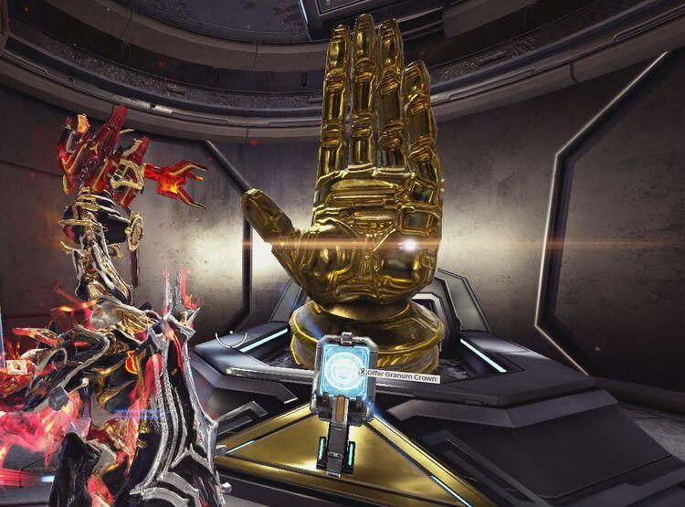 Golden-hand-offer-granum-crown
