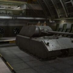 A front right view of a Maus in a garage