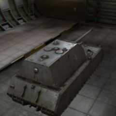 A rear right view of a Maus in a garage