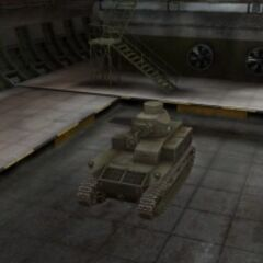 A front left view of a T2 Medium Tank in a garage