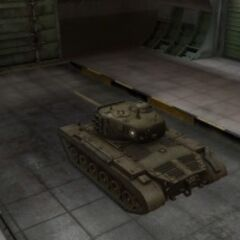 A rear left view of a M26 Pershing in a garage