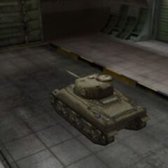 A rear left view of a M4 Sherman in a garage
