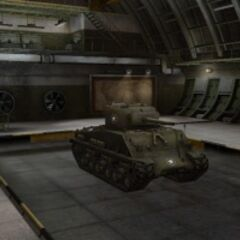A front right view of a M4A3E8 Sherman in a garage