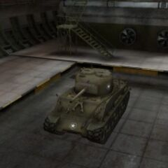 A front left view of a M4A3E8 Sherman in a garage