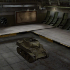 A front right view of a M8A1 in a garage