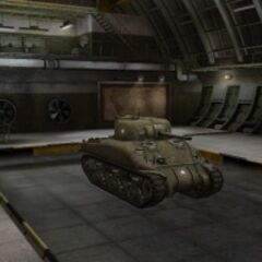 A front right view of a M4 Sherman in a garage
