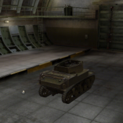 A rear right view of a M8A1 in a garage