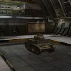 A front right view of a M2 Light Tank in a garage