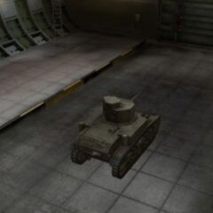 A rear right view of a M3 Stuart in a garage