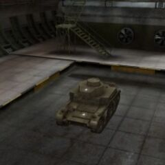 A front left view of a M2 Light Tank in a garage