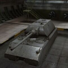 A front left view of a Maus in a garage