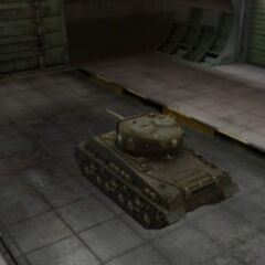 A rear left view of a M4A3E8 Sherman in a garage