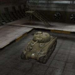 A front left view of a M4 Sherman in a garage