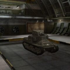 A front right view of a M2 Medium Tank in a garage