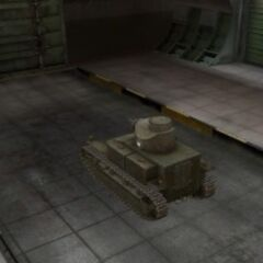 A rear left view of a T2 Medium Tank in a garage
