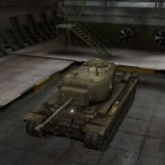 A front left view of a T29 in a garage