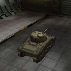 A rear right view of a M4 Sherman in a garage