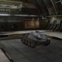 A front right view of a Jagdpanzer 38(t) Hetzer in a garage