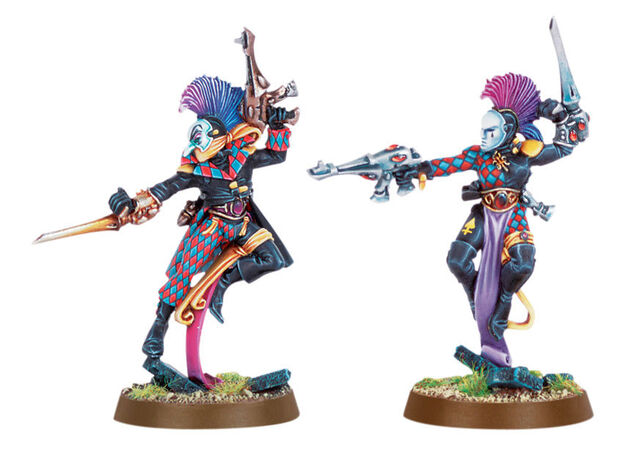 File:Warhammer 40k Games Workshop Ad Imagery Harelquin Eldar with kisses weaponry 873x627.jpg