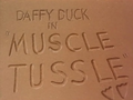 Muscle Tussle Title Card
