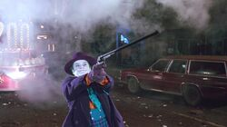 Joker shooting the Batwing