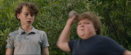 Ben throwing a rock at Henry Bowers