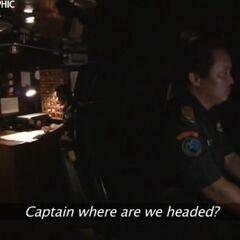В капитанской рубке.