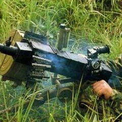 Российский солдат ведёт огонь из АГС-30.