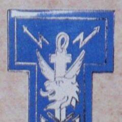 Эмблема батальона связи. Буква Т, в форме которой выполнена эмблема, отсылает к французскому слову