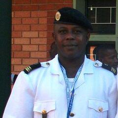 Капитан жандармерии. Знаки различия — французские, эмблема жандармерии на правом нагрудном кармане.