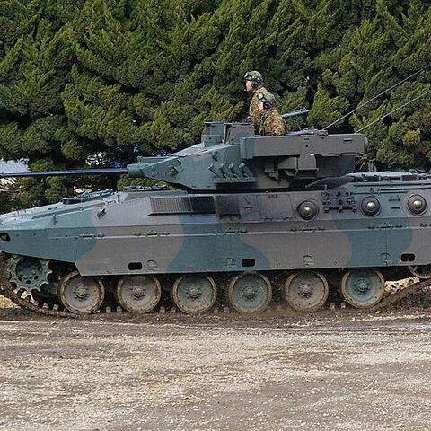 БМП Тип 89 с двумя ПУ ПТУР по бортам бронебашни.