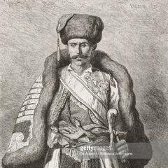Сенатор из Черногории, 1876 г. Данный персонаж, скорее всего, относится к более ранему времени, поскольку в 1870-х гг. черногорские сенаторы уже должны были носить полагающиеся им грбови. Автор гравюры — Теодор Валерио.
