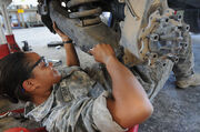 US Navy 100510-N-7456N-023 Army Sgt. Sierra Bibbs installs brakes on a Humvee at the battalion motor pool