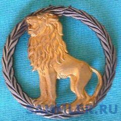 Первая эмблема конголезской армии, которую военные этой страны носили на берете и фуражке с начала и до конца 60-х гг.