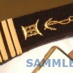 Погон капитана 1-го ранга ВМС Того.