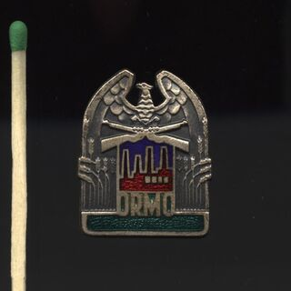 Эмблема ORMO в сравнении с обычной спичкой.