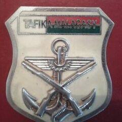 Эмблема вооруженных сил Мадагаскара, которая носится на правом нагрудном кармане.