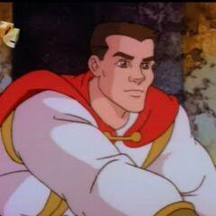 Артур протягивает кулак к центру Круглого Стола.