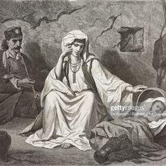 Семья из Черногории, 1876 г. Грбови на капе мужчины говорит о том, что он либо племенной капитан, либо перяник. Справа подвешено его оружие. Автор гравюры — Теодор Валерио.