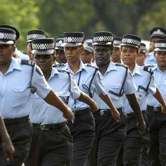 Женщины-офицеры полиции во время парада в честь международного женского дня.