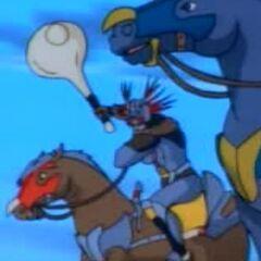 Бэш атакует верхом на своем коне.