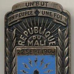 Эмблема связистов, которая отличается по своей символике от других эмблем связистов, принятых во франкоязычных армиях Африки.