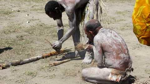 Asaro Mud Man makes fire