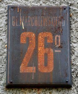 Stara tabliczka adresowa Al. Jana Pawła II 26a