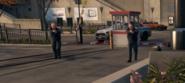 Policeofficerslooking.PNG